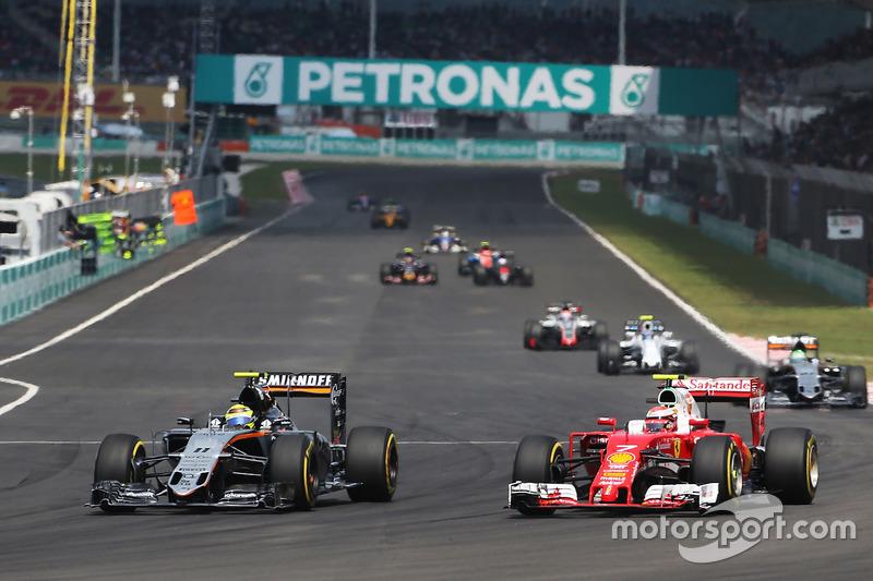 (L to R): Sergio Perez, Sahara Force India F1 VJM09 and Kimi Raikkonen, Ferrari SF16-H battle for po