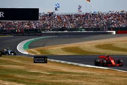 Kimi Raikkonen, Ferrari SF71H, leads Valtteri Bottas, Mercedes AMG F1 W09