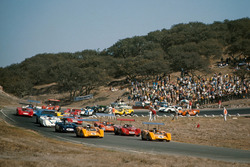 Denny Hulme, McLaren M8B Chevrolet and Bruce McLaren, McLaren M8B Chevrolet lead the field