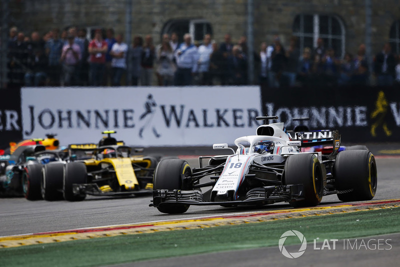 Lance Stroll, Williams FW41, Carlos Sainz Jr., Renault Sport F1 Team R.S. 18, y Valtteri Bottas, Mercedes AMG F1 W09