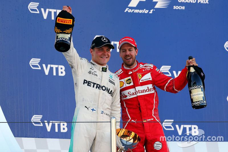 Race winner Valtteri Bottas, Mercedes AMG F1, Sebastian Vettel, Ferrari