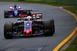 Romain Grosjean, Haas F1 Team VF-17, leads Daniil Kvyat, Scuderia Toro Rosso STR12
