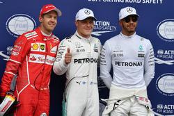 Polesitter Valtteri Bottas, Mercedes AMG F1, second place Sebastian Vettel, Ferrari, third place Lew