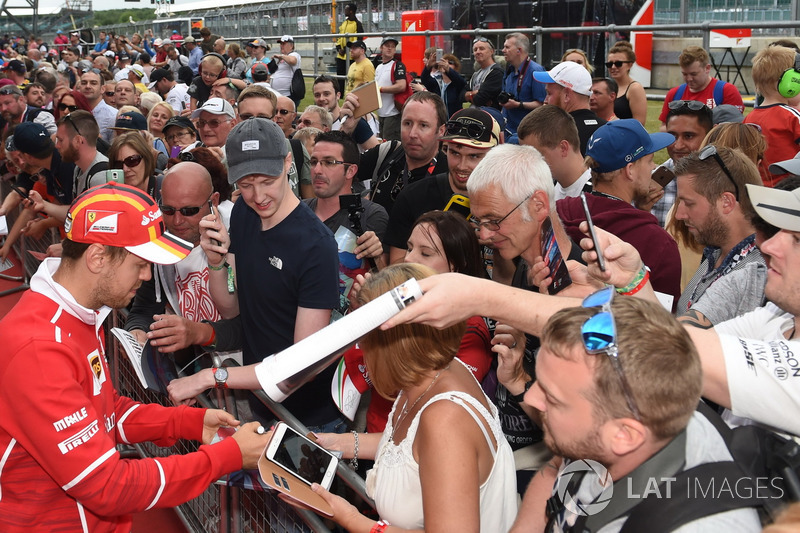 Sebastian Vettel, Ferrari signs autographs for the fans at the autograph session