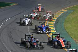 Jenson Button, McLaren MP4-31 and Pascal Wehrlein, Manor Racing MRT05