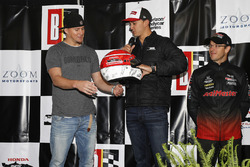Actor Channing Tatum is presented with a helmet autographed by the entire Honda driver field by Graham Rahal, Rahal Letterman Lanigan Racing Honda