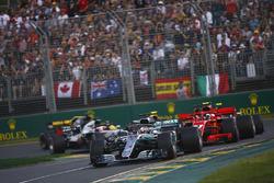 Lewis Hamilton, Mercedes AMG F1 W09, leads Kimi Raikkonen, Ferrari SF71H, Sebastian Vettel, Ferrari SF71H, Kevin Magnussen, Haas F1 Team VF-18 Ferrari, Max Verstappen, Red Bull Racing RB14 Tag Heuer, and Romain Grosjean, Haas F1 Team VF-18 Ferrari, at the