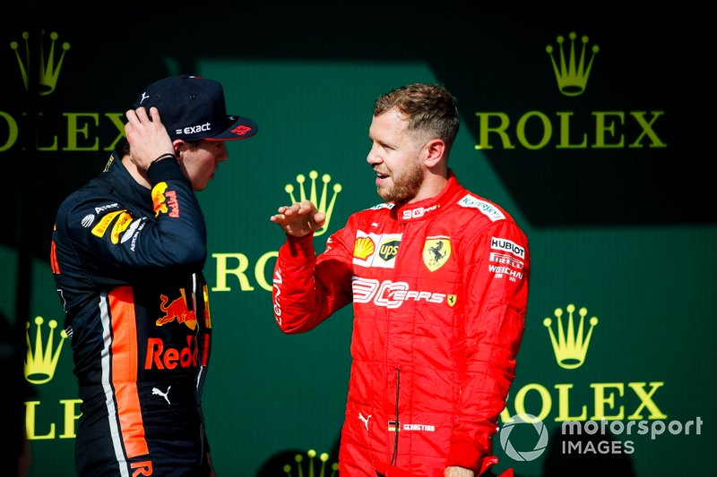 Max Verstappen, Red Bull Racing, 2nd position, talks with Sebastian Vettel, Ferrari, 3rd position, on the podium