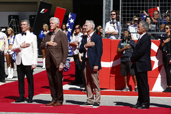 Michael Buffer and former US President Bill Clinton and Chase Carey, Chairman, Formula One, stand fo