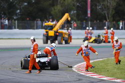Marshals clear the track after an opening lap accident involving Pierre Gasly, Toro Rosso STR13, Romain Grosjean, Haas F1 Team VF-18 and Nico Hulkenberg, Renault Sport F1 Team R.S. 18