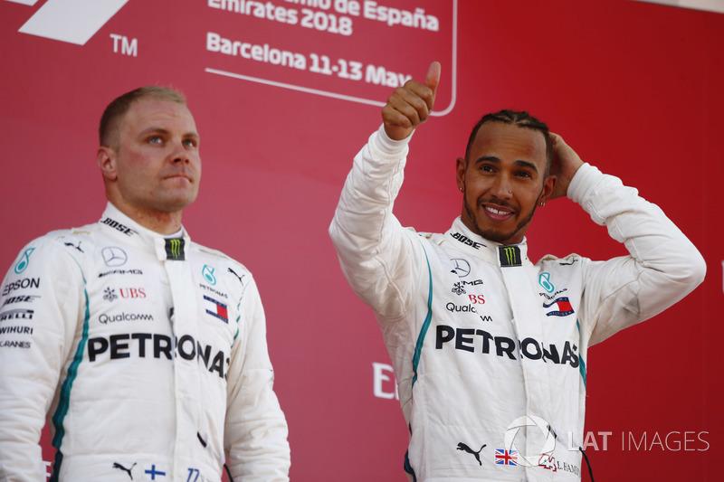 Lewis Hamilton, Mercedes AMG F1, celebrates victory on the podium with Valtteri Bottas, Mercedes AMG F1
