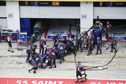 Carlos Sainz Jr., Scuderia Scuderia Toro Rosso STR12, is returned to his garage and retired from the race