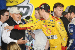 Rick Hendrick is congratulated by Joey Logano, Team Penske Ford