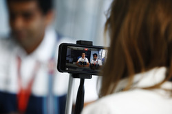 Paul di Resta and Karun Chandhok are filmed in a Williams hospitality area