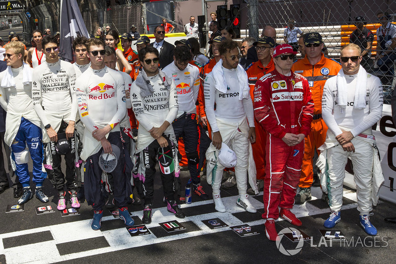 Drivers observe the National Anthem on the grid