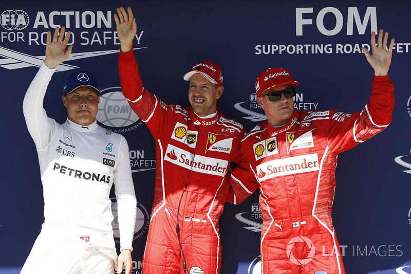 Ganador de la pole Sebastian Vettel, Ferrari, segundo puesto Kimi Raikkonen, Ferrari y el tercero Valtteri Bottas, Mercedes-Benz F1