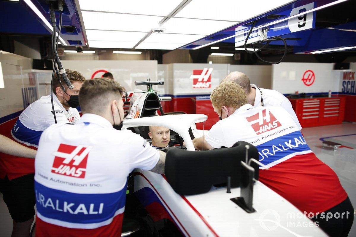 Nikita Mazepin, Haas F1, in cockpit in the team's garage