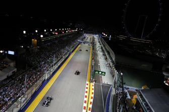 Lewis Hamilton, Mercedes AMG F1 W09 EQ Power+, leads Max Verstappen, Red Bull Racing RB14, Sebastian Vettel, Ferrari SF71H, Valtteri Bottas, Mercedes AMG F1 W09 EQ Power+, and the rest of the field on the formation lap