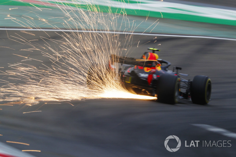 Sparks fly from the car of Max Verstappen, Red Bull Racing RB14 Tag Heuer