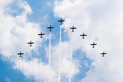 The Escuadrilla Acrobatica del Colegio del Aire trail the colours of the Mexican flag in smoke across the sky, prior to the start of the race