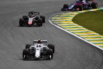 Charles Leclerc, Sauber C37 leads Romain Grosjean, Haas F1 Team VF-18