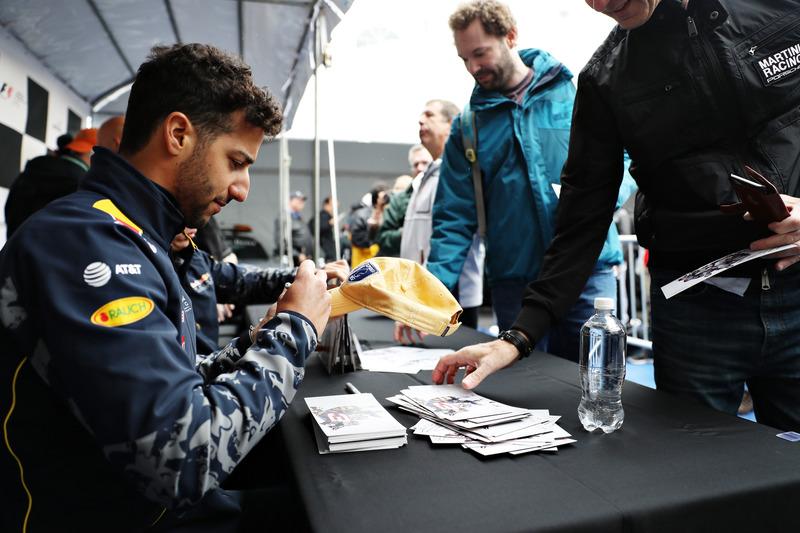 Daniel Ricciardo, Red Bull Racing signs autographs for fans