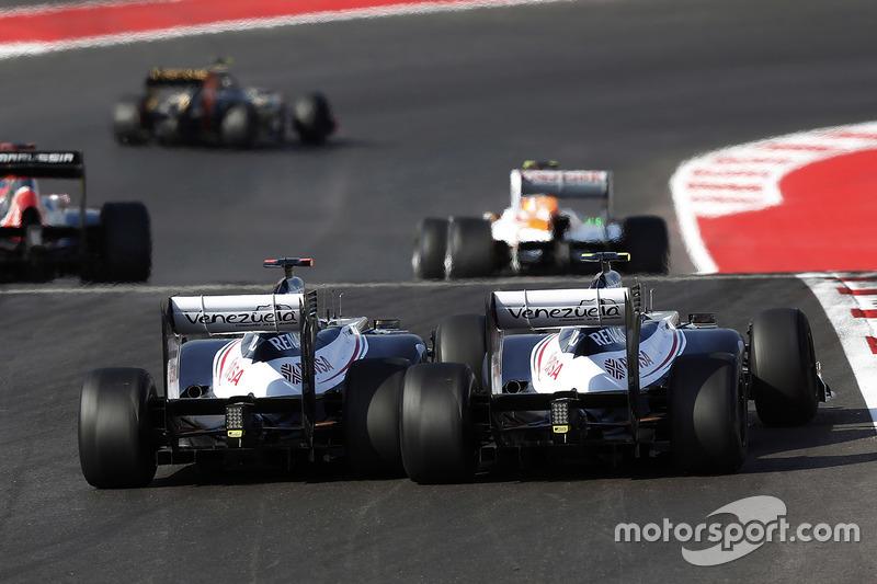 Pastor Maldonado, Williams FW34, passes teammate Bruno Senna, Williams FW34