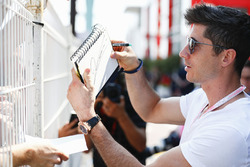 Robert Lewandowski signs autographs for fans
