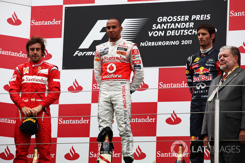 The podium: Fernando Alonso, Ferrari, Lewis Hamilton, McLaren and Mark Webber, Red Bull Racing