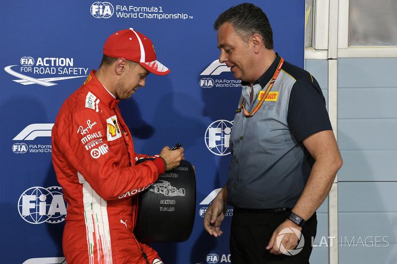 Sebastian Vettel, Ferrari receives the Pirelli Pole Position award from Mario Isola, Pirelli Sportin