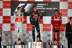 Podium: winner Sebastian Vettel, Red Bull Racing, second place Jenson Button, McLaren, third place F