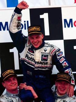 Jacques Villeneuve, Williams is lifted shoulder high by Mika Hakkinnen, McLaren and David Coulthard, McLaren
