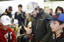 Fernando Alonso, McLaren, meets the grid kids