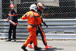 Max Verstappen, Red Bull Racing walks away with a marshal after crashing