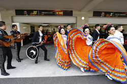 Mexican dancers and a mariachi band in front of the McLaren Honda garage