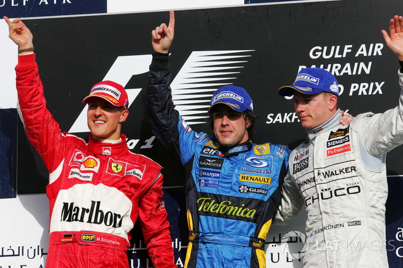 Podium: second place Michael Schumacher, Ferrari, Race winner Fernando  Alonso, RenaultF1 Team