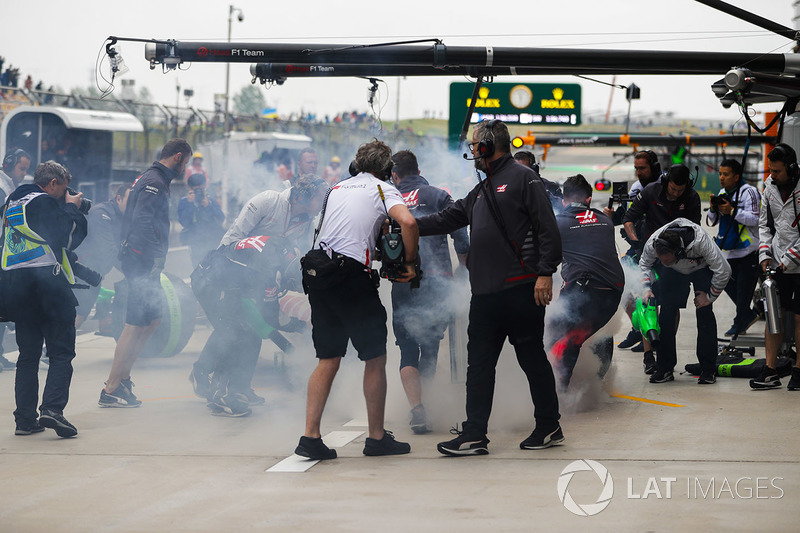 Haas F1 engineers in the pit lane