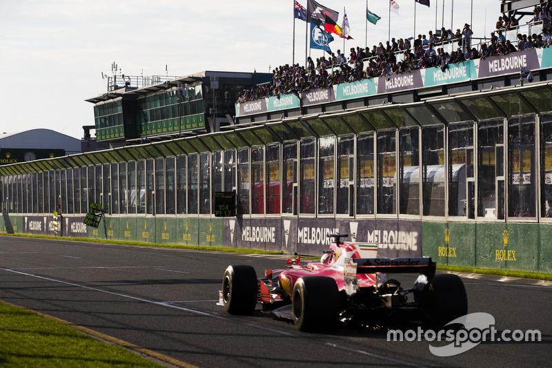Sebastian Vettel, Ferrari SF70H, passes his pit board
