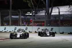 Felipe Massa, Williams FW40 leads Romain Grosjean, Haas F1 Team VF-17