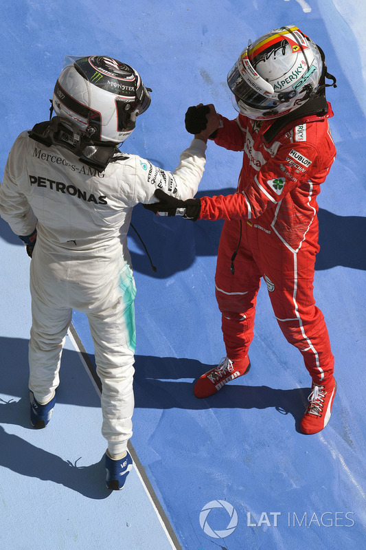 Valtteri Bottas, Mercedes AMG F1 and Sebastian Vettel, Ferrari celebrate in parc ferme