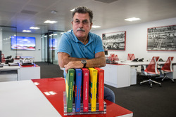 Rainer W. Schlegelmilch poses in the Motorsport Network office