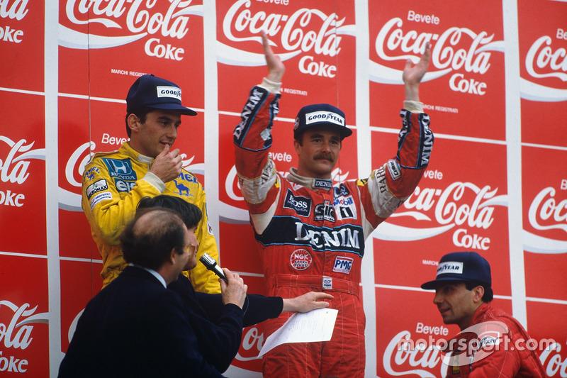 Podium: pemenang Nigel Mansell, Williams, posisi dua Ayrton Senna, Team Lotus, posisi ketiga Michele Alboreto, Ferrari