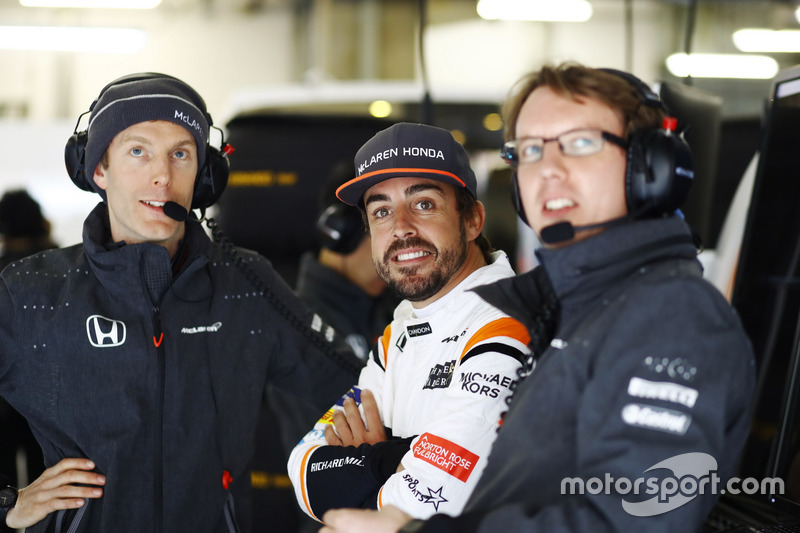 Fernando Alonso, McLaren, with colleagues in the team's garage
