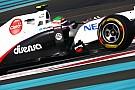 Photos show Sauber with UBS sponsor logos