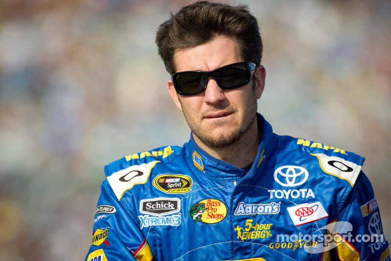 Truex Jr. discusses with the media racing at Kansas