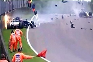 Formula 1 Special feature Maldonado Crashes under Red Flag in WSR nearly hitting two marshalls - Video