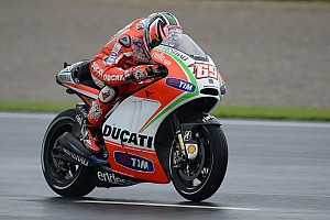 MotoGP Practice report Third and fifth best times for Hayden and Rossi on wet Valencia track