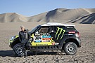 Jay Leno gets behind the wheel of the Dakar winning Mini