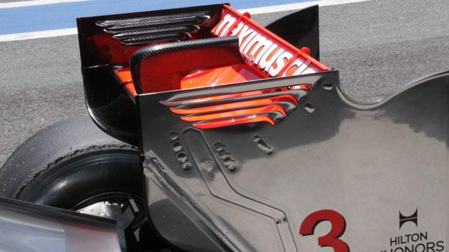 Button: ala posteriore scarica, tempo sul giro alto