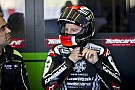 Rea, Guintoli top Tuesday test sessions, Menghi airlifted to hospital